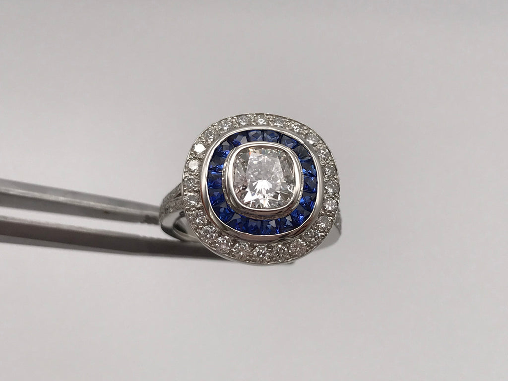 Platinum GIA, 1.04ct, F, VS1 diamond and sapphire double halo ring