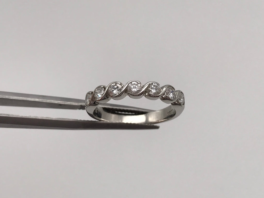 Platinum 0.65ct diamond bezel set eternity ring