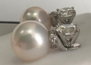 A pair of detachable pearl drop for diamond studs
