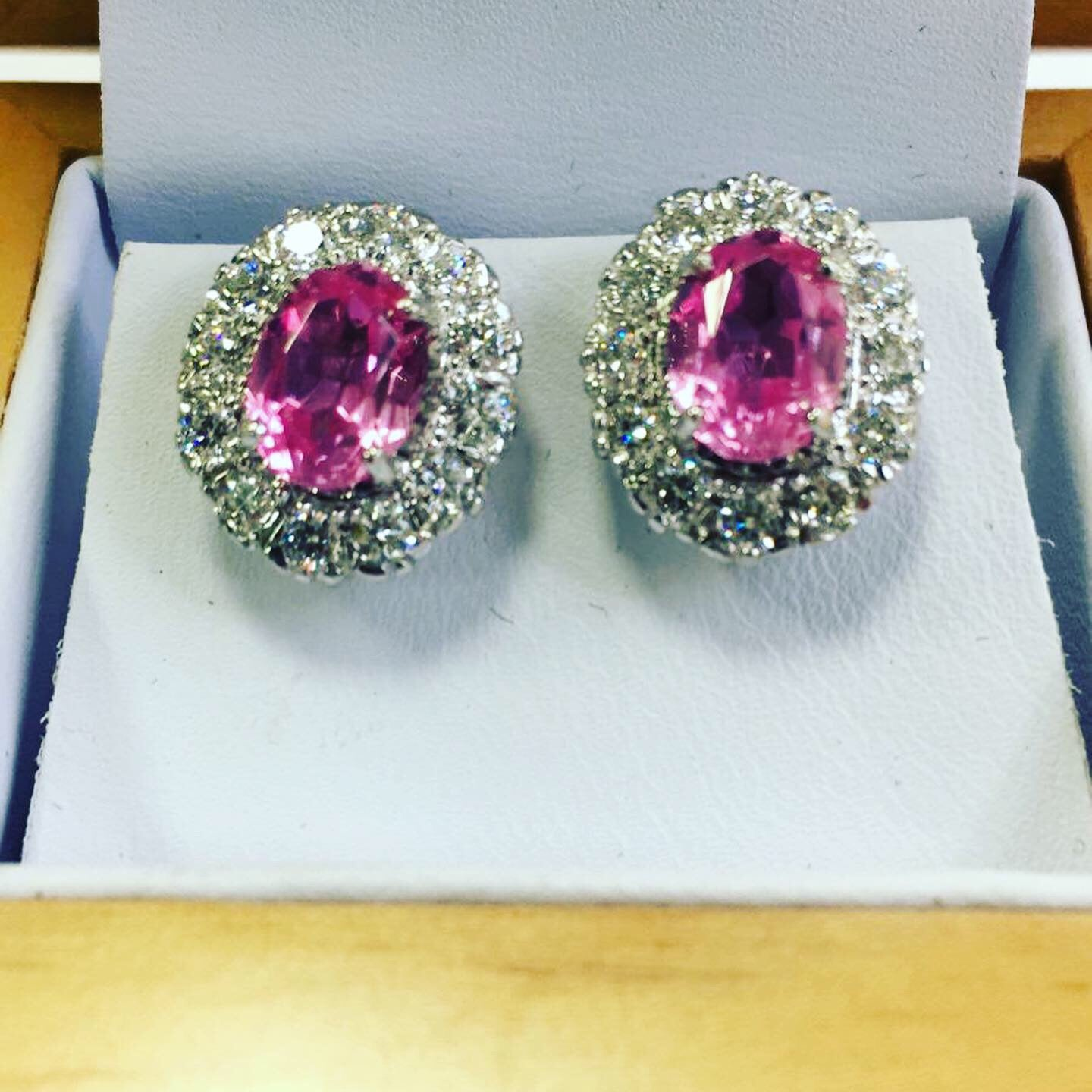 A pair of pink sapphire and diamond cluster stud earrings