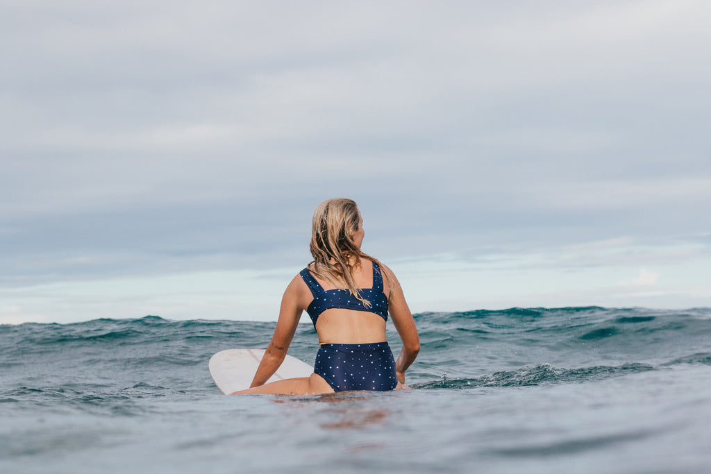 Miki Webster roadtests the new Salt Gypsy Luna Surf Crop. Sustainable style in the lineup shot by Mims Radford | www.saltgypsy.com #saltgypsy #sustainableswimwear #sustainablesurf #styleinthelineup #womenwhosurf
