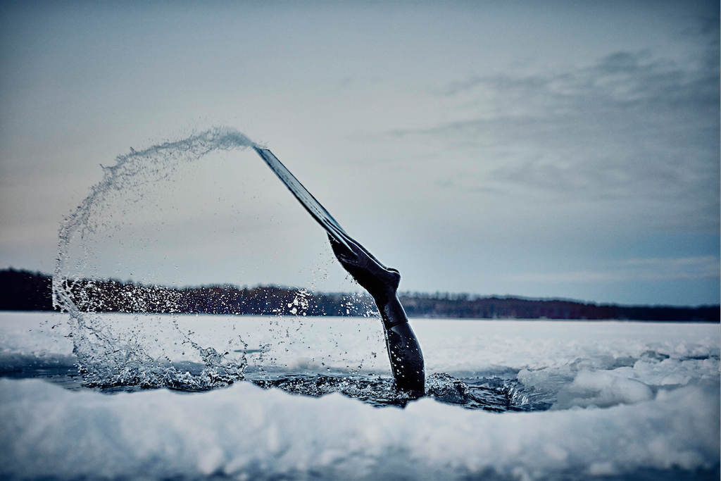 A still from Nowness featuring Finnish free diver Johanna Nordblad as she dives beneath a frozen lake