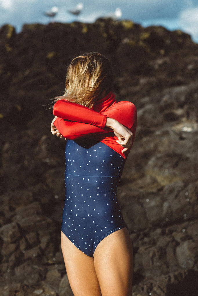 Montana Lower wears Salt Gypsy sustainable ocean activewear. The Navy & Gold Collection 2017 | www.saltgypsy.com #saltgypsy #activewear #activeswim #beachactive #womenwhosurf #surf #sustainableswim