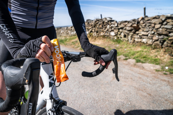 A cyclists using a beta alanine energy bar before cycling uphill