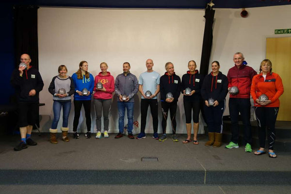 Completers of the Brathay 10 in 10 2020 stand with their awards