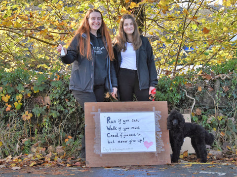 Two girls show support for the Brathay 10in10 runners with a home made sign