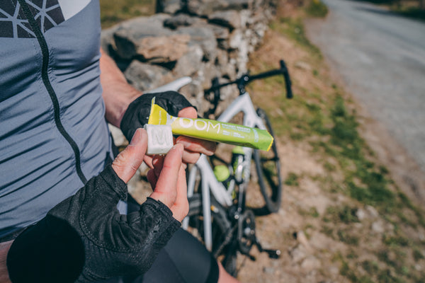 A cyclists with an Electro Energy Pocket Rocket and one block of the bar held in his fingers