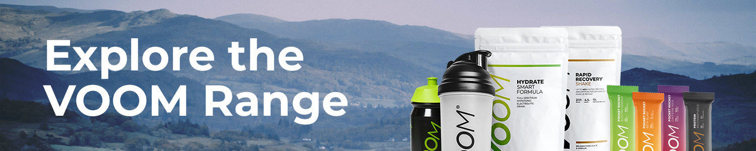 VOOM's range of sports nutrition products superimposed on a range of hills with the words Explore the VOOM range.