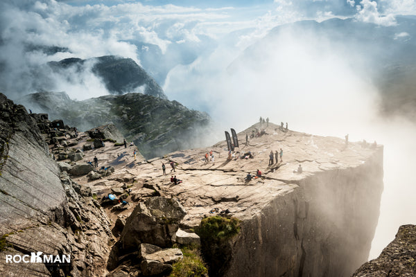 Breath taking view over Lysefjord and the surrounding mountains from the Preikestolen Pulpit Rock summit as competitors reach the checkpoint during the Rockman swimrun event.