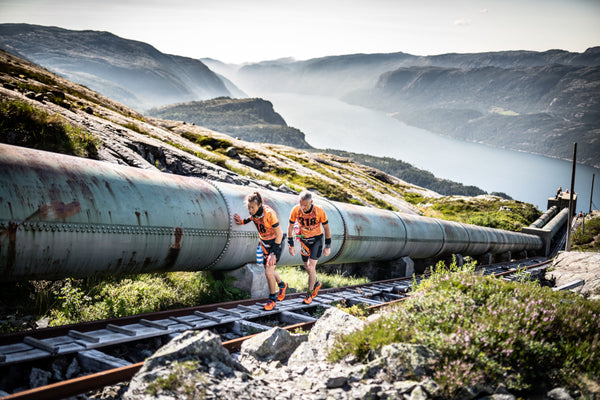 A mixed pair tackle the Flørli Stairs above Lysefjord during the Rockman Swim Run event