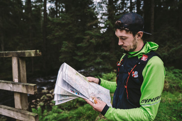 A male runner looking at a map and making plans for training