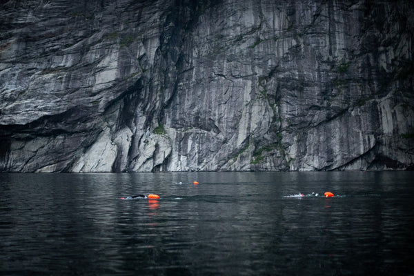 Cold open water swimming in a moody fjord during ThorXtri event.