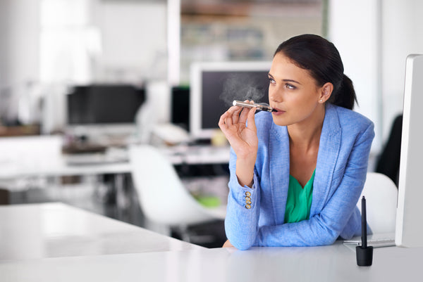 woman vaping in office