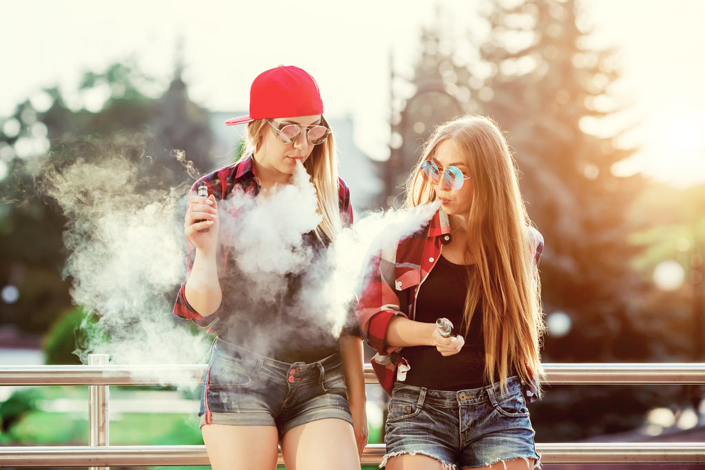 two women vaping VG e-liquid bases