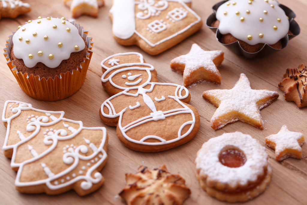 an image of gingerbread cookies and other various Christmas cookies