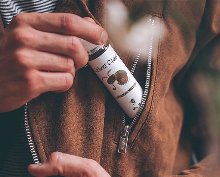 a man storing is Velvet Cloud e-liquid in his jacket's pocket