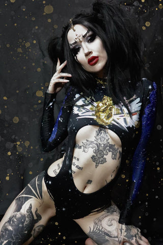 Black Haired Women Posing with Cut Out Bodysuit