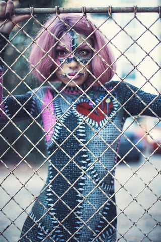 Pink Haired Women wearing Voodoo Doll Costume