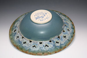 Functional Art. Studio Pottery. Wheel Thrown Bowl With Wide Pierced Rim, Slip Trailing Designs, and Layered Glazes. High Fired In An Electric Kiln.