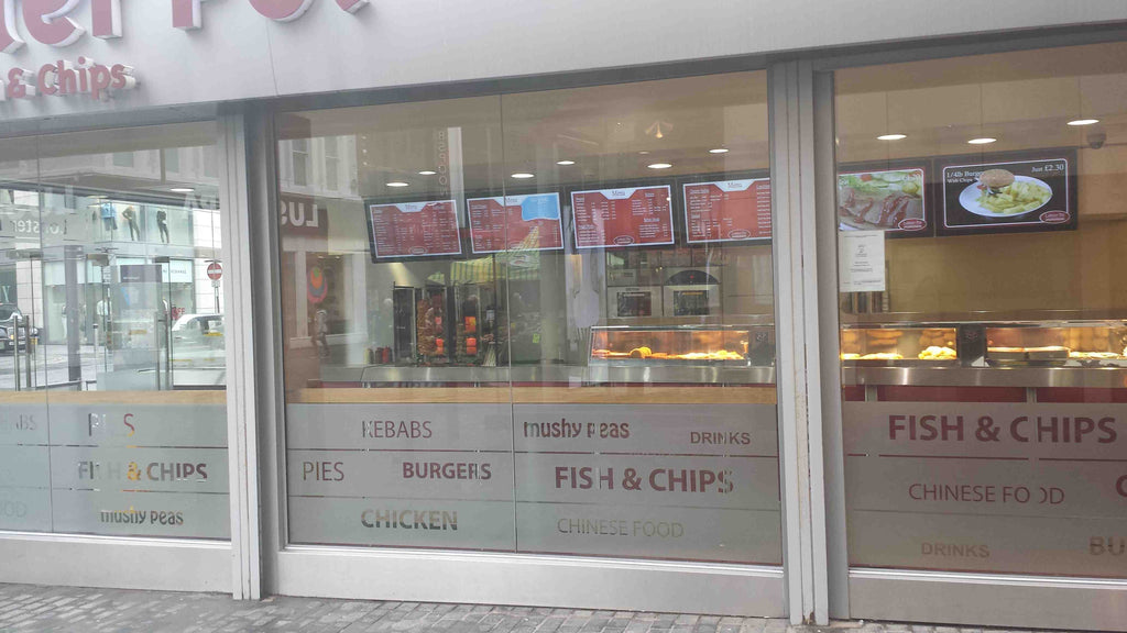 exterior view of takeaway shop with digital menu boards