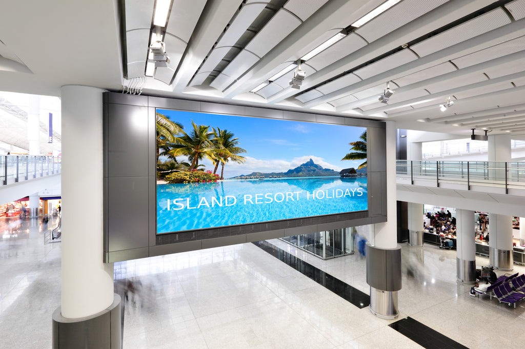 Large fabric faced light box in an airport departure lounge