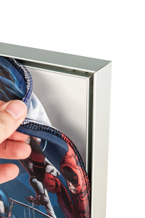 Image showing installation of fabric graphic into aluminium frame