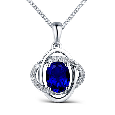 Birthday Gift 14K White Gold or Sterling Silver Women's Pear-shaped Cross Necklace with Oval Blue Sapphire Stone Wiley Hart