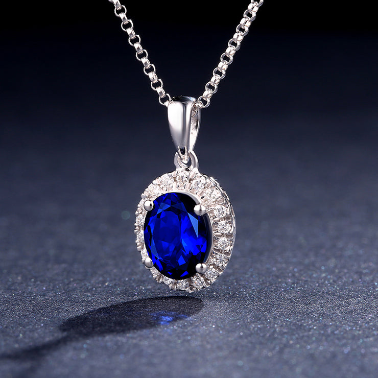 Wiley Hart 14K White Gold or Sterling Silver Women's Oval Halo Engagement Pendant Necklace with Vintage Inspired Blue Sapphire Stone