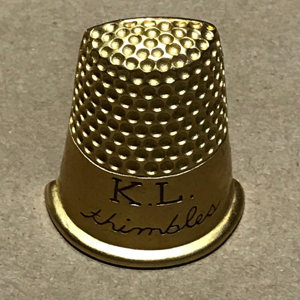 KARL LAGERFELD THIMBLE BROCH Archive