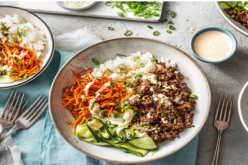 Beef Bulgogi Bowls with Carrots, Pickled Cucumber & Sriracha Crema over Jasmine Rice