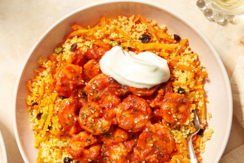 Shrimp in Spicy Harissa Sauce with Couscous, Olives, & Currants