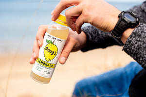 Doug's Lemonade, Original Lemonade, Photo on the Beach, Opening the Bottle in the Summer