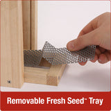 Close up of rust-free, removable fresh seed tray on Nature's Way Vertical Mesh cedar bird Feeder