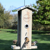 Birds feeding from Nature's Way Wild Wings decorative weathered vertical feeder with multiple feeding ports and perch platforms
