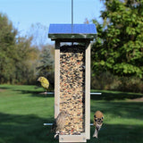 Birds visiting Nature's Way Wild Wings decorative weathered vertical feeder with multiple feeding ports and perch platforms