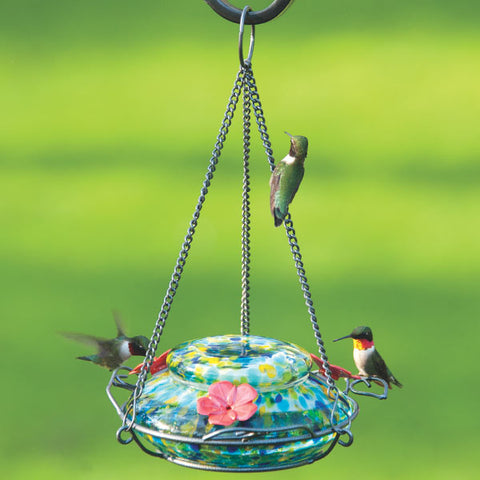 Three hummingbirds feeding from the Nature's Way Illuminated Hummingbird hand blown glass Feeder