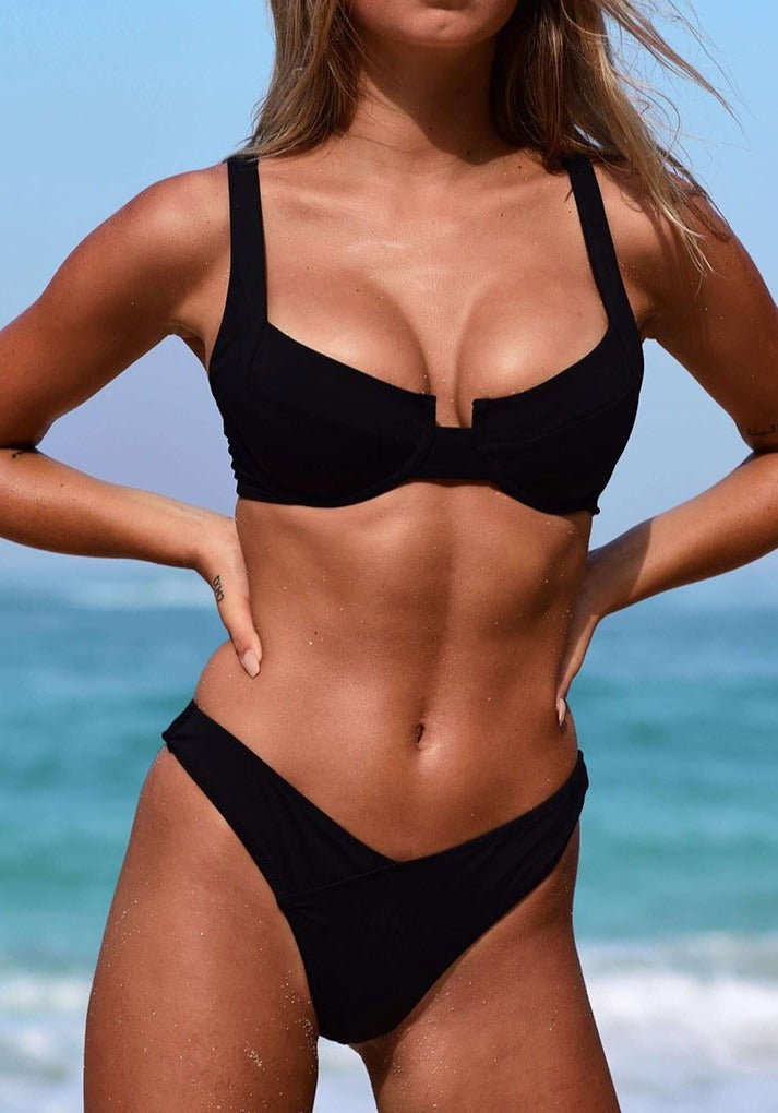 model wearing black underwire bikini supportive and modern