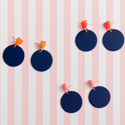 womens navy circle earrings with pink, neon red, and orange heart studs katie bartels