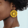 yellow circle laser cut earrings with tigerseye gemstone studs