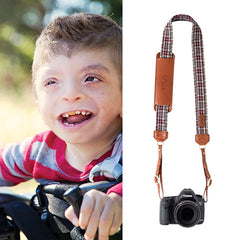 "The Titus Fotostrap is named after Titus Daily, from the Fotolanthropy story ""Unexpected Joy"". You can visit www.Fotolanthropy.com to watch Titus's, and more inspiring true stories of everyday heroes."