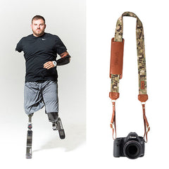 "The Travis Fotostrap is named after SSG Travis Mills, from the Fotolanthropy award-winning documentary ""Travis: A Soldier's Story"". You can visit www.Fotolanthropy.com to watch Travis's, and more inspiring true stories of everyday heroes."