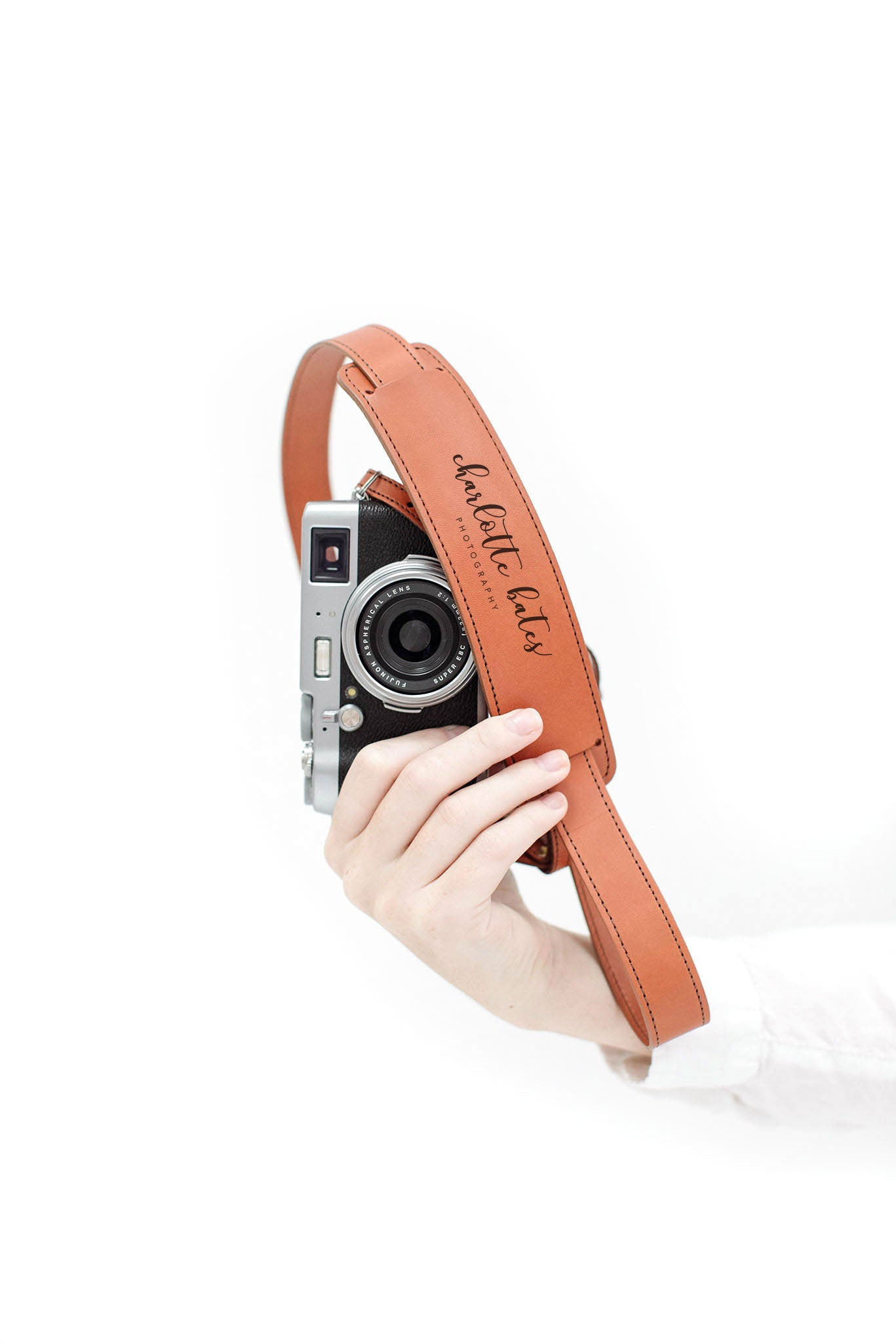 FOTO | The Skinny Cognac - a cognac brown genuine all-leather skinny camera strap that can be personalized with a monogram or business logo, making this leather camera strap the perfect personalized gift.
