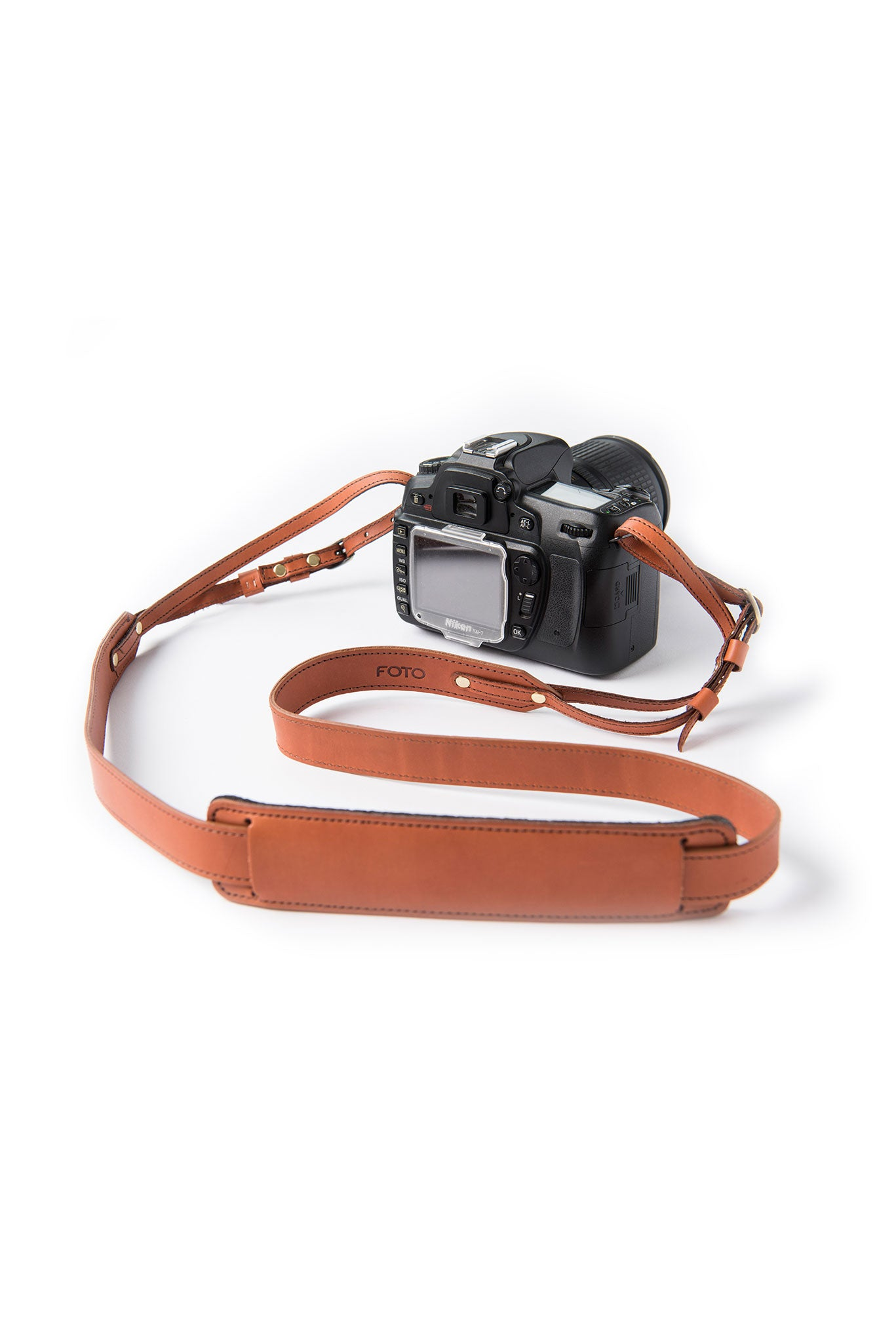 FOTO | The Skinny Cognac for Him - a cognac brown genuine all-leather skinny camera strap that can be personalized with a monogram or business logo, making this leather camera strap the perfect personalized gift.