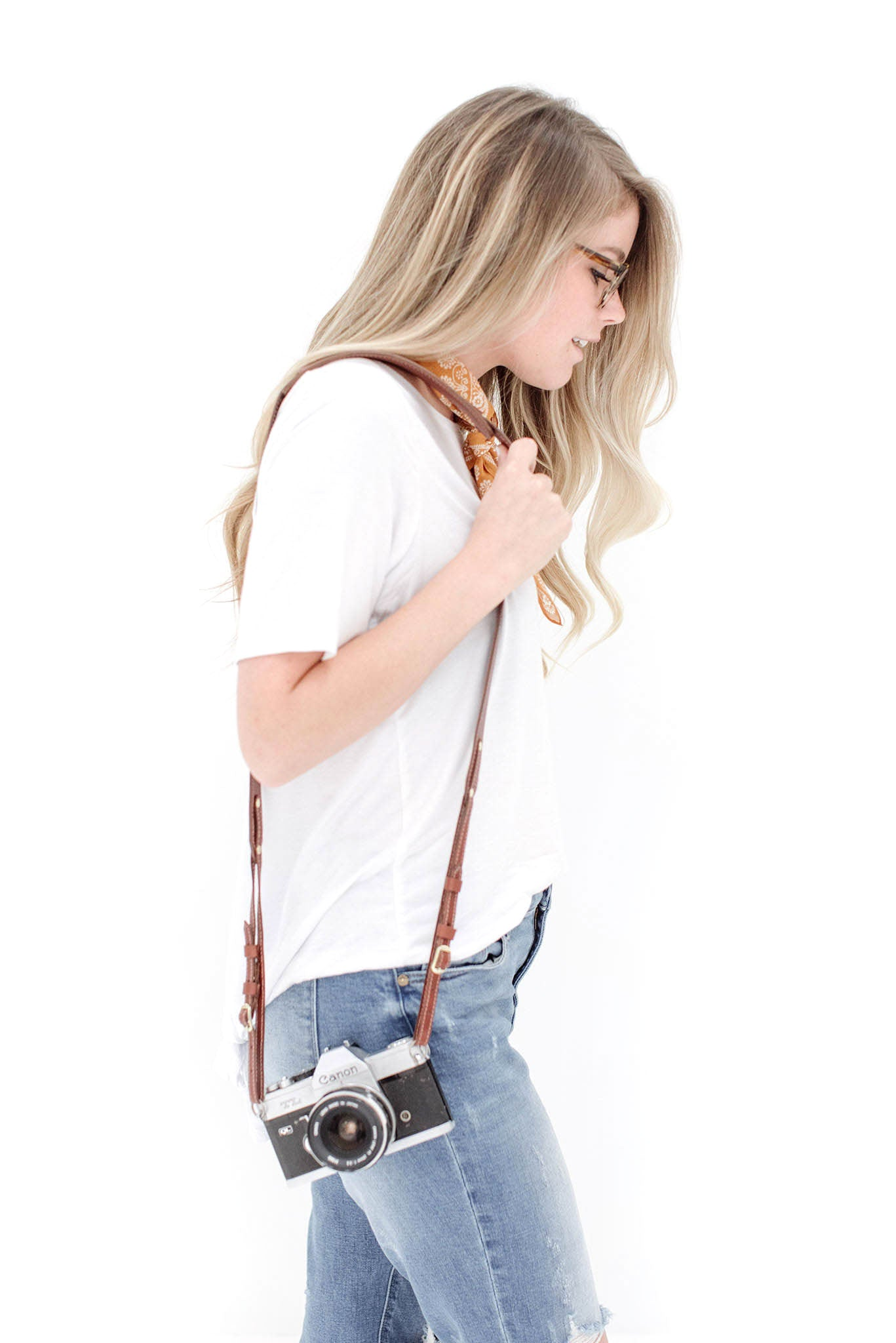 FOTO | The Skinny Dutch - a medium brown genuine all-leather skinny camera strap that can be personalized with a monogram or business logo, making this leather camera strap the perfect personalized gift.