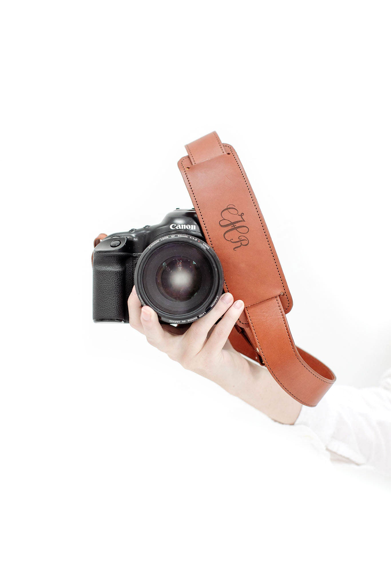 FOTO | James Fotostrap - a cognac brown genuine all-leather camera strap that can be personalized with a monogram or business logo, making this leather camera strap the perfect personalized gift.