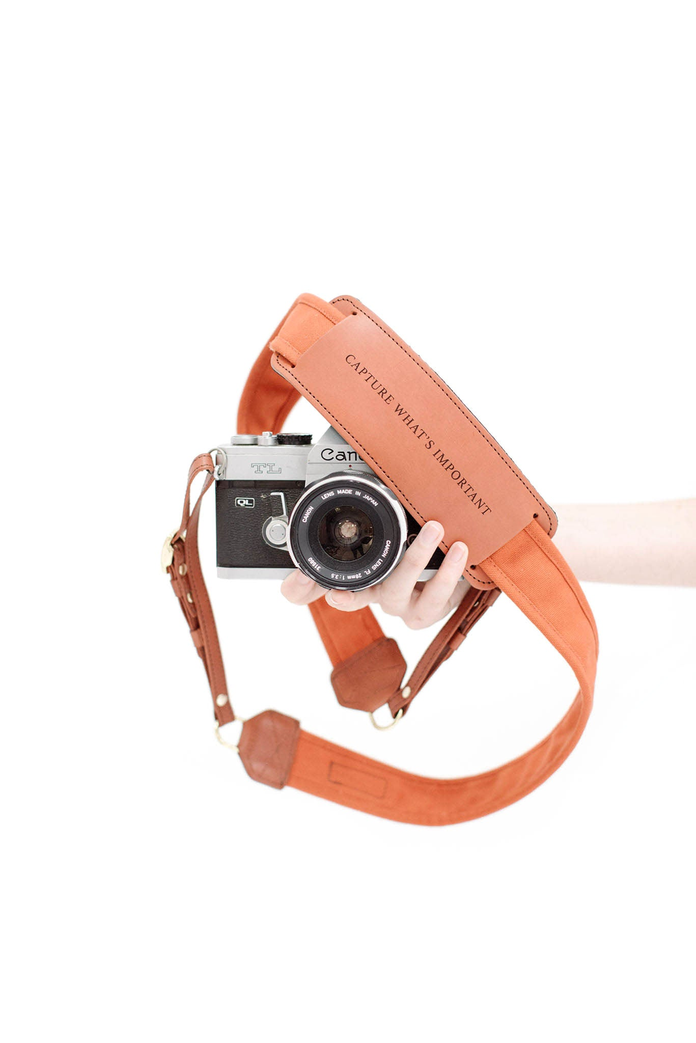FOTO | Sweet Potato Fotostrap - a burnt orange canvas and genuine leather camera strap that can be personalized with a monogram or business logo, making it the perfect personalized gift!