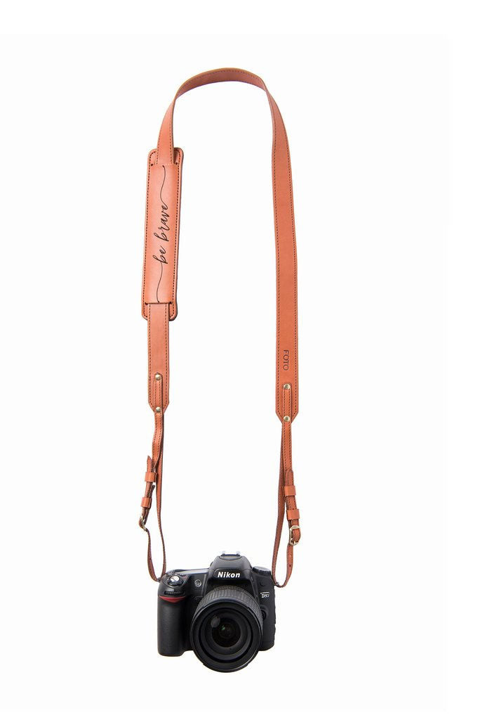 "FOTO | ""Be Brave"" Skinny Fotostrap - this genuine leather skinny camera strap is available in cognac and black leather, making it the perfect photographer gift!"