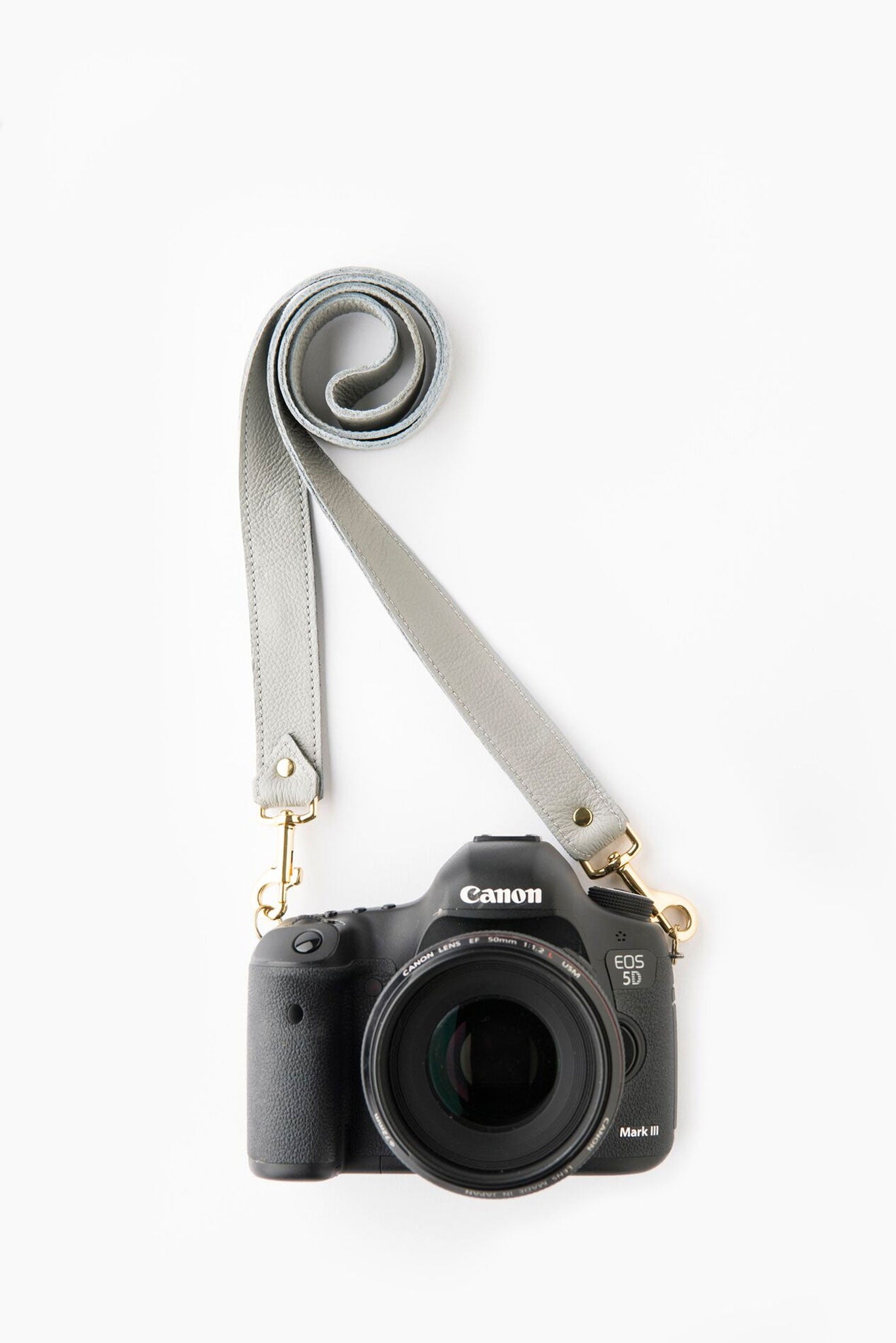 FOTO | The Designer in Dove - a dove grey genuine pebbled leather camera strap that can be personalized with a monogram or business logo, making this leather camera strap the perfect personalized gift.