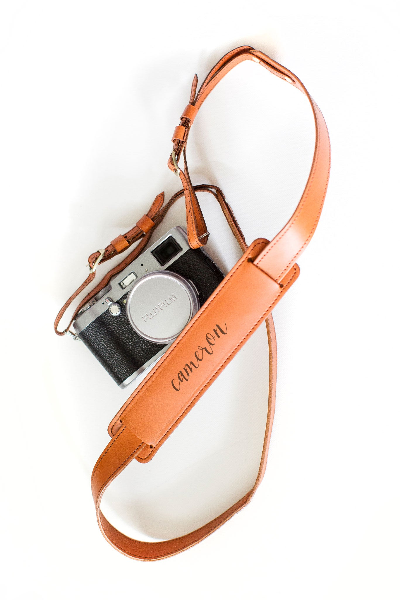 FOTO | The Skinny Cognac for Her - a cognac brown genuine all-leather skinny camera strap that can be personalized with a monogram or business logo, making this leather camera strap the perfect personalized gift.