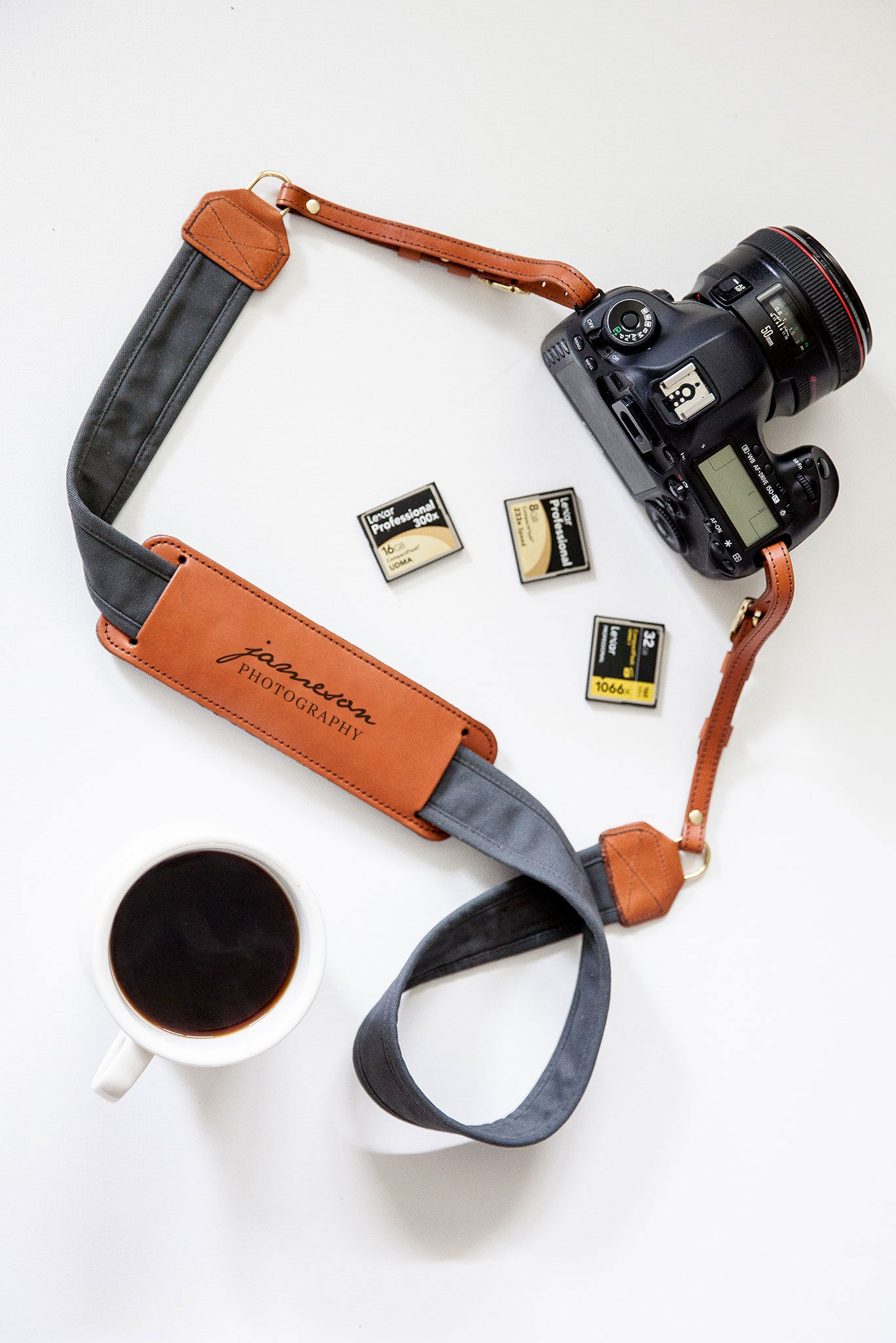 FOTO | Graphite Fotostrap for Him - a charcoal gray canvas and genuine leather camera strap that can be personalized with a monogram or business logo, making it the perfect personalized gift!